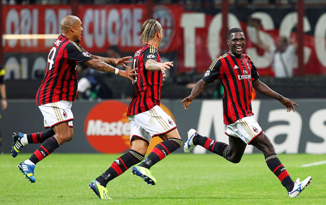 Cristian Zapata (right) of AC Milan celebrates with his team-mates Philippe Mexes (centre) and Nigel De Jong after scoring the opening goal against Celtic
