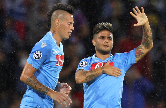 Lorenzo Insigne (right) of SSC Napoli celebrates with his teammate Marek Hamsik after scoring his team's second goal