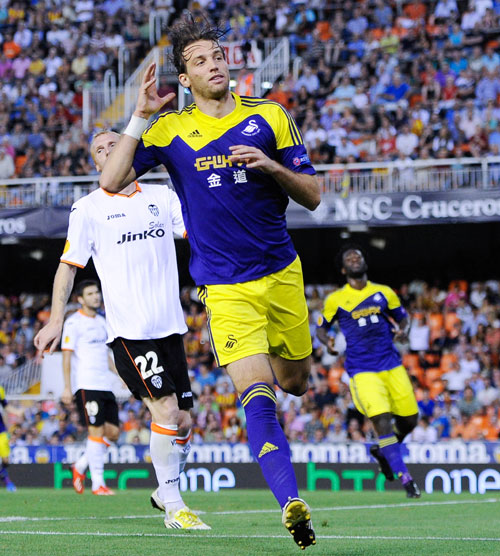 Michu of Swansea City celebrates after scoring his team's second goal