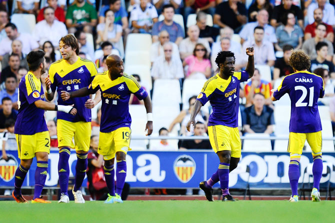 Wilfried Bony of Swansea City (second right) celebrates after scoring the opening goal
