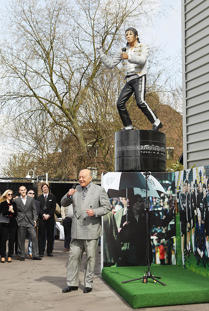 Former Fulham chairman Mohamed Al Fayed unveils a statue in tribute to Michael Jackson at Craven Cottage on April 3, 2011