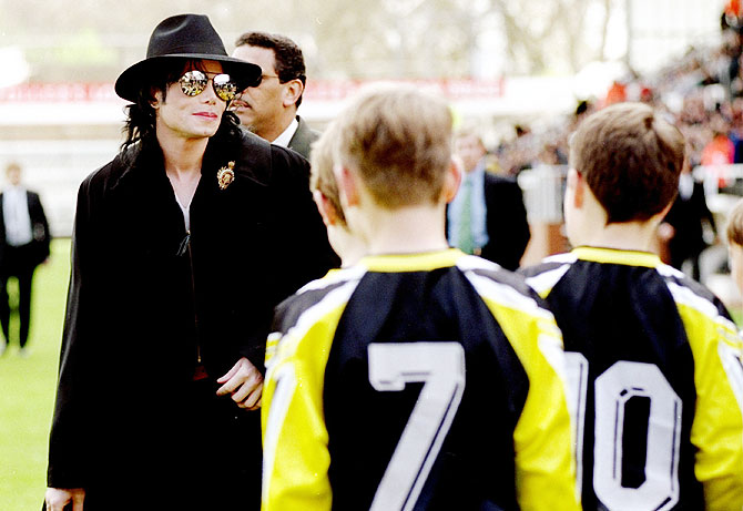 Michael Jackson meets the Fulham ball boys before the match between Fulham and Wigan Athletic in the Nationwide 2nd Division, at Craven Cottage, London. in April 1999
