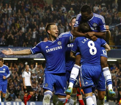 Chelsea players celebrate after John Obi Mikel scored the second goal against Fulham