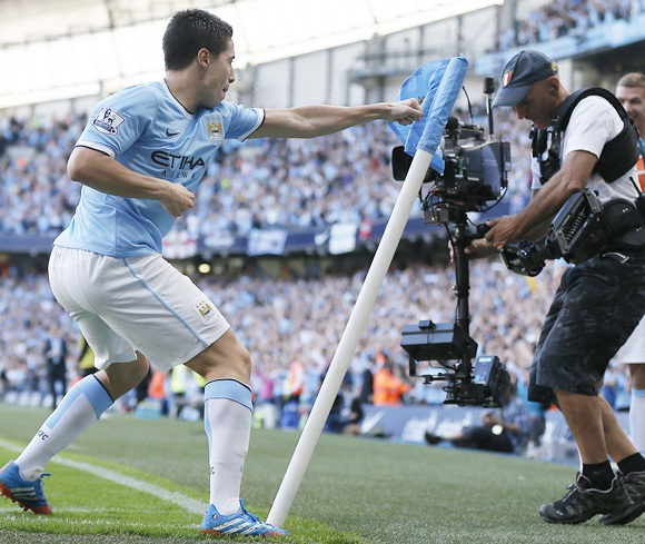 Manchester City's Samir Nasri celebrates scoring against Manchester United