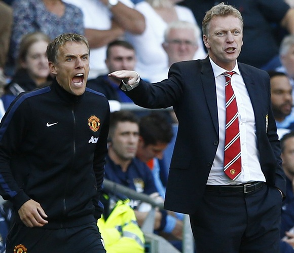 Manchester United's manager David Moyes (right) and assistant Phil Neville