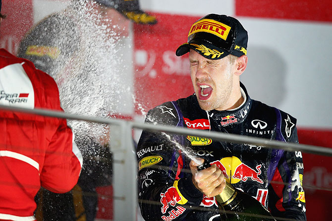 Sebastian Vettel of Germany and Infiniti Red Bull racing celebrates following his victory during the Singapore Formula One Grand Prix at Marina Bay Street Circuit in Singapore on Sunday