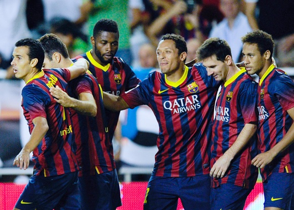 Pedro Rodriguez (left) of FC Barcelona celebrates with his team-mates after scoring his team's second goal