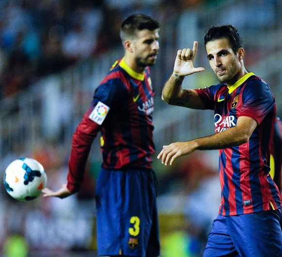 Cesc Fabregas (right) of FC Barcelona celebrates after scoring his team's fourth goal