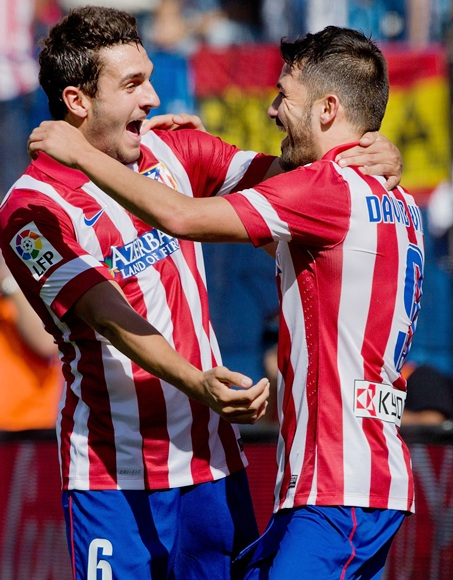 David Villa (right) of Atletico de Madrid celebrates scoring their opening goal with team-mate Koke