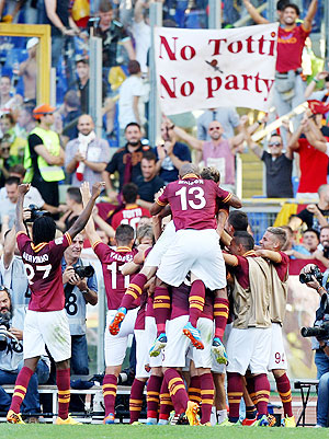 AS Roma players celebrate the team's second goal scored by Adem Ljaijc during the Serie A match against SS Lazio