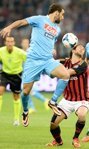 Roma win derby at last, Napoli sink Milan