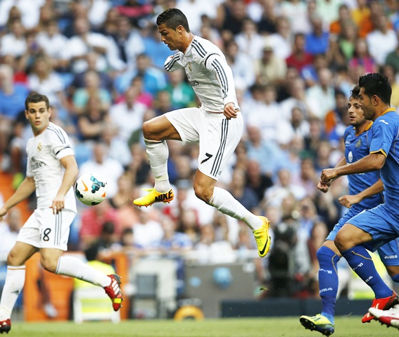 Real Madrid's Cristiano Ronaldo kicks the ball