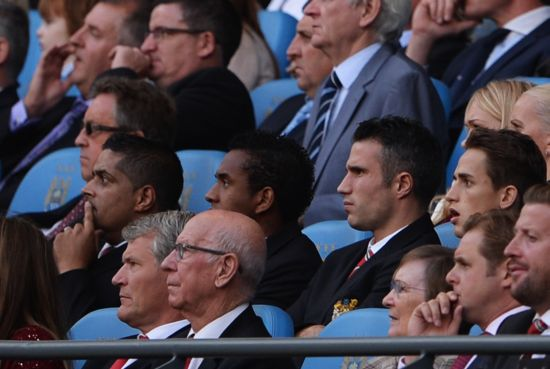 Robin van Persie of Manchester United looks on from the stands during the Barclays Premier League match between Manchester City and Manchester United at the Etihad Stadium