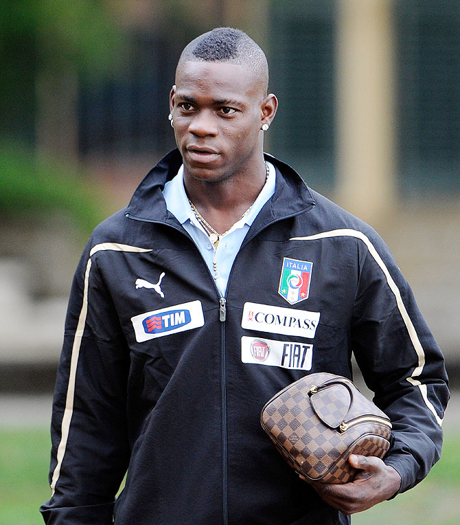 Mario Balotelli arrives for a training session with Italy's national squad
