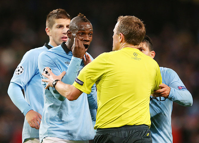 Mario Balotelli argues with referee Peter Rasmussen after being denied a penalty during Manchester City's UEFA Champions League Group D match against Ajax Amsterdam in November 2012