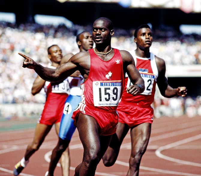 Ben Johnson celebrates winning the gold in the men's 100 metres at the Seoul Olympic Games on September 24, 1988.