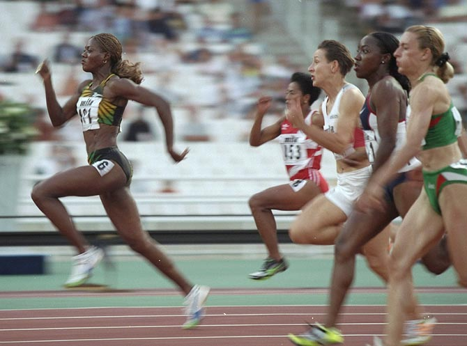 Merlene Ottey (left) takes the lead during a 100 metres race at the World Championships at the Olympic Stadium in Athens, on August 2, 1997