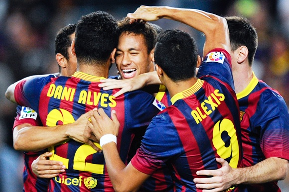 Neymar (centre) of FC Barcelona celebrates with his team-mates