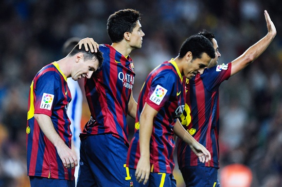 Marc Bartra (second left) of FC Barcelona celebrates with his team-mates Lionel Messi (L) Pedro Rodriguez (second right) and Xavi Hernandez