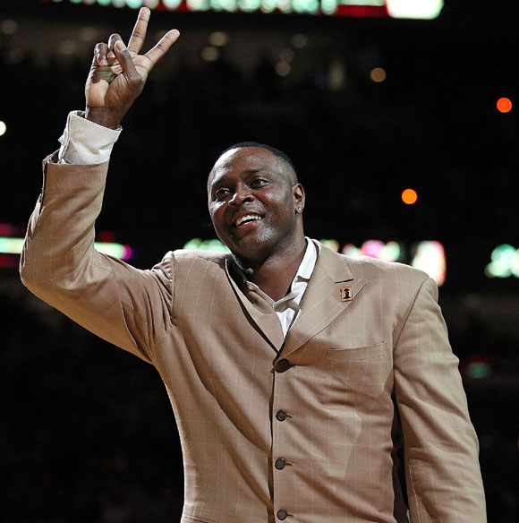 Former player Horace Grant of the Chicago Bulls waves to the crowd