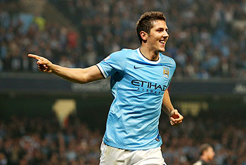 Stevan Jovetic of Manchester City celebrates after scoring the fourth goal during the Capital One Cup third round match against Wigan Athletic at Etihad Stadium in Manchester on Tuesday
