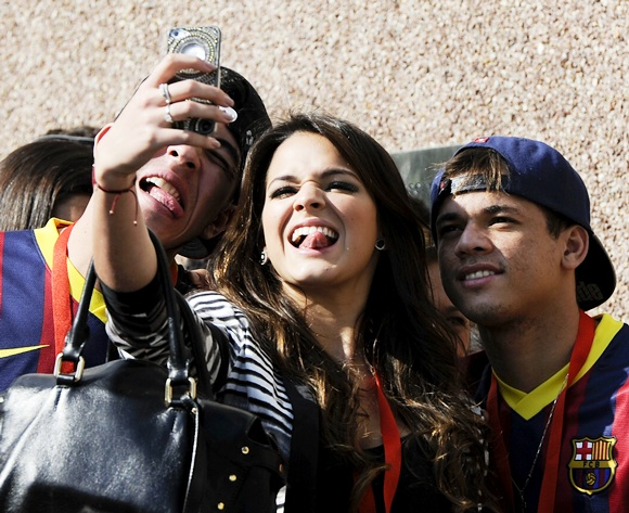 Neymar's girlfriend Bruna Marquezine shares a joke during her boyfriend's official presentation as a new player of the FC Barcelona at Camp Nou