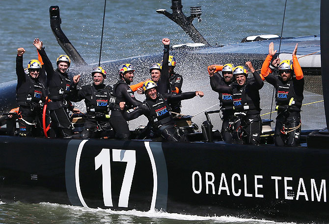 Oracle Team USA skippered by James Spithill celebrates after they beat Emirates Team New Zealand to defend the America's Cup during the final race on in San Francisco, California