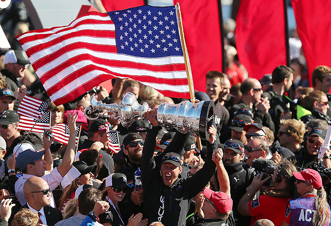 Oracle Team USA skippered by James Spithill celebrates after defeating Emirates Team New Zealand skippered by Dean Barker during the final race of the America's Cup Finals San Francisco, California, on Wednesday