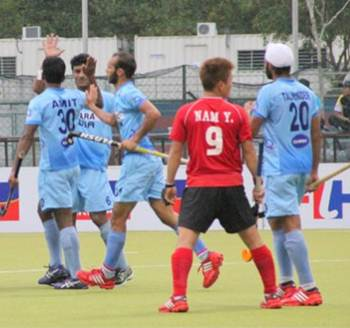 Indian players celebrate a goal