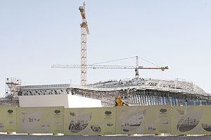 Labourers work at the construction site of Qatar Foundation headquarters in Doha in preparation for the 2022 Football World  Cup in Qatar