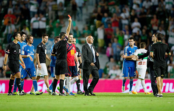 Referee Cesar Muniz Fernandez shows the red card to Carlos Sanchez of Elche FC after their La Liga match at Estadio Manuel Martinez Valero in Elche on Wednesday