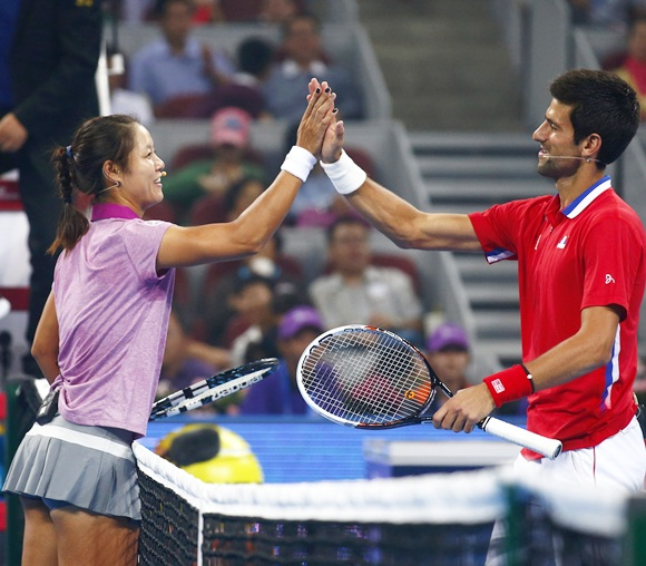 Serbia's Novak Djokovic (right) celebrates with China's Li Na after an exhibition charity match