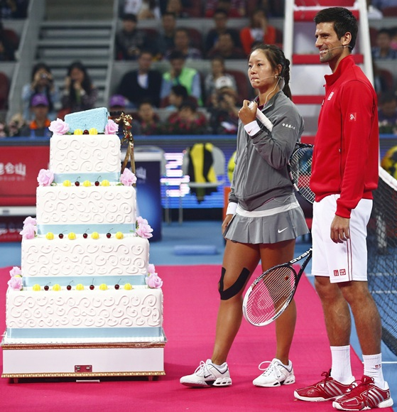 Serbia's Novak Djokovic (right) with China's Li Na