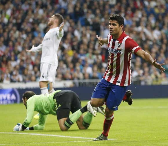 Atletico Madrid's Diego Costa (left) celebrates a goal with teammates Filipe and Koke (right)