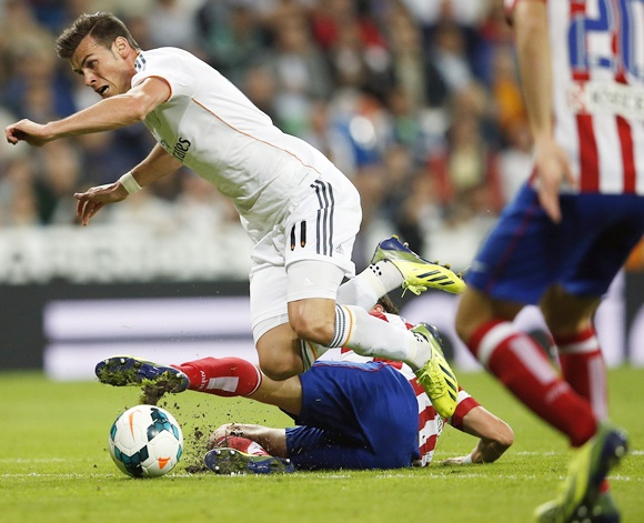 Real Madrid's Gareth Bale (left) fights for the ball with Atletico Madrid's Filipe Luis (bottom)
