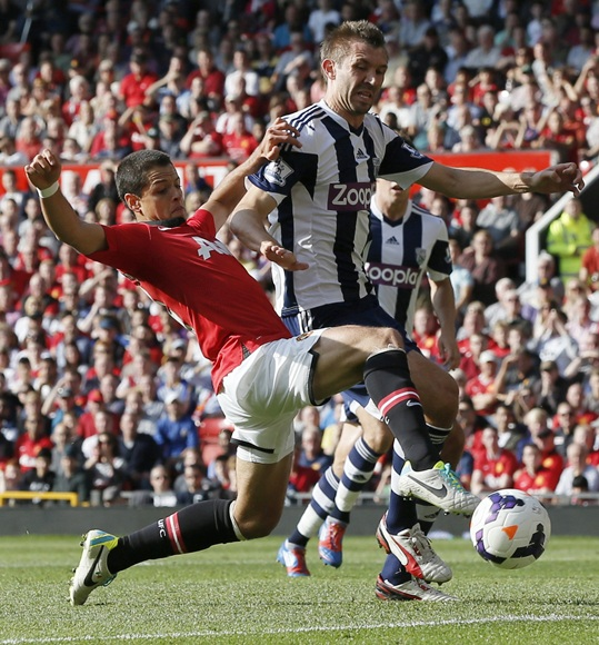 Manchester United's Javier Hernandez (left) challenges West Bromwich Albion's Gareth McAuley