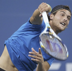 Unheralded Joao Sousa completed a fairytale run at the Malaysian Open on Sunday when he beat France's Julien Benneteau 2-6, 7-5, 6-4 in the final to become the first Portuguese to win an ATP Tour title.