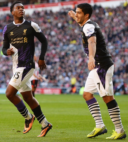 Daniel Sturridge (left) of Liverpool celebrates scoring the opening goal with Luis Suarez