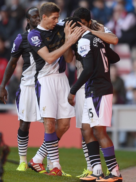 Steven Gerrard of Liverpool celebrates with Luis Suarez and Daniel Sturridge