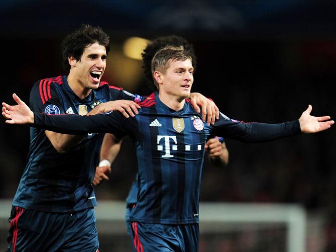 Toni Kroos of Bayern Muenchen with Javi Martinez