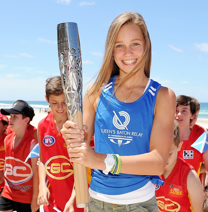 Eve Lutze poses with the Queen's Baton as the Commonwealth Games Baton arrives on the Gold Coast on November 1, 2013 in Surfers Paradise, Australia.