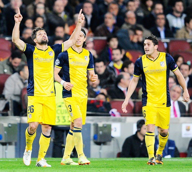 Diego,left, of Club Atletico de Madrid celebrates scoring the opening goal with Filipe Luis and Koke