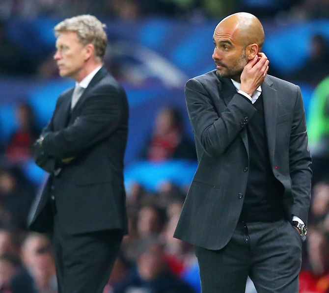 Pep Guardiola head coach of Bayern Muenchen scratches his head