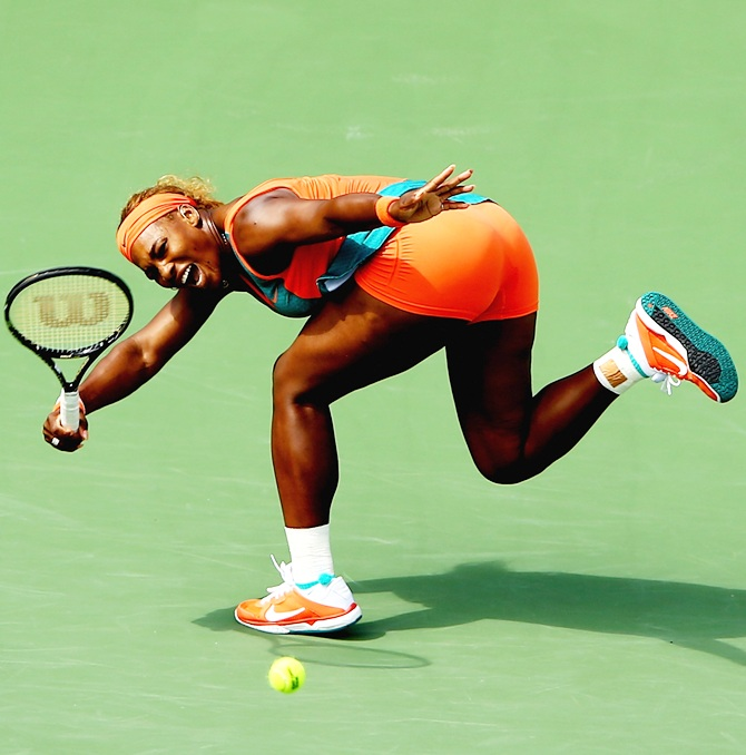 Serena Williams of the USA returns a shot