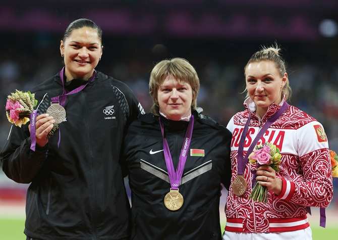 Silver medalist Valerie Adams of New Zealand, gold medalist Nadzeya   Ostapchuk of Belarus and bronze medalist Evgeniia Kolodko of Russia   pose on the podium during the medal ceremony for the Women's Shot Put during the London 2012 Olympic Games