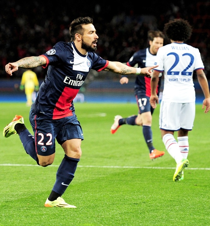 Ezequiel Lavezzi of PSG celebrates after scoring the opening goal against Chelsea
