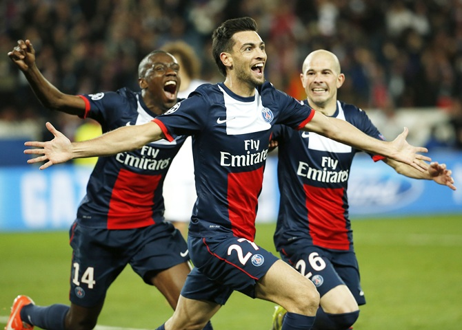 Paris St Germain's Javier Patore, centre, celebrates with teammates after scoring the third goal