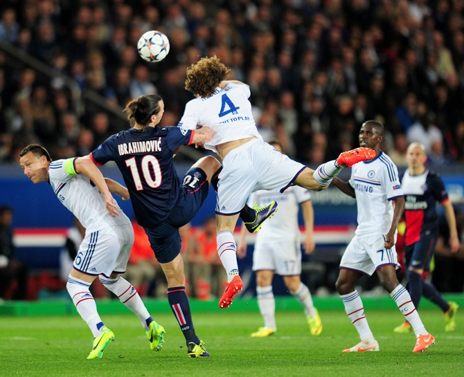 Zlatan Ibrahimovic of PSG battles for a header with John Terry,left, and David Luiz,right, of Chelse