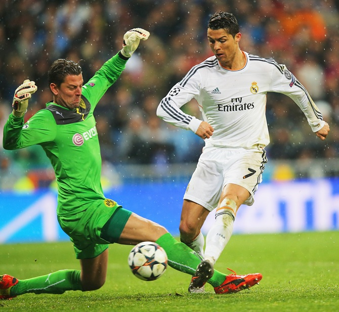 Cristiano Ronaldo of Real Madrid scores past Roman Weidenfeller of Borussia Dortmund