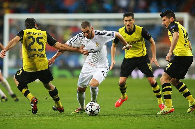 Karim Benzema of Real Madrid takes on Sokratis Papastathopoulos of Borussia Dortmund